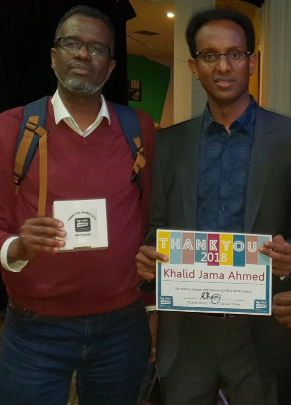 Abdi Mohamed and Khalid Ahmed receiving Up Our Street Thank You Awards 2018