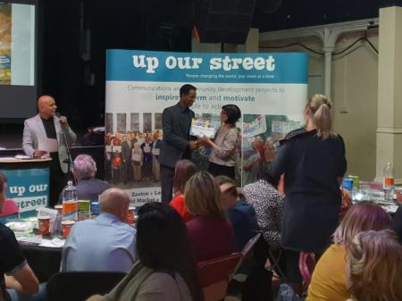Khalid Ahmed receiving award at the Up Our Street Thank You Awards 2018