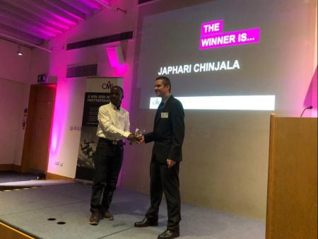Matt Rogers presenting Japhari Chinjala with a GPD Award in Coventry