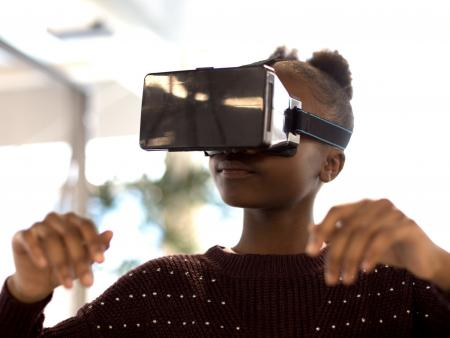 UKBlackTech image of young black girl using virtual reality technology
