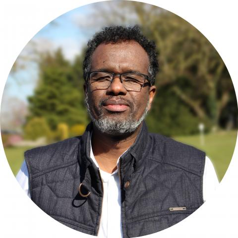 A headshot of Abdi Mohamed who has experience in refugee integration and employment in Bristol